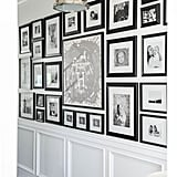 Our gallery wall down the hallway in our entrance is perfect in my eyes. It was exactly what I visualized. Inspired by a huge wall at Club Monaco here in Vancouver, I knew I wanted to recreate a similar look in our own home. We sourced black frames of all sizes to display black and white photos of some of our favourite memories. In the middle you'll find a framed Hermes scarf that was a gift from my mom for my 28th Birthday. The big H represents the iconic brand, but also acts as a Hibbs crest in our home. It took hours, days, weeks to complete, with endless trips looking for the perfect size frame. But all that work paid off as it was one of the most rewarding projects! While completing the gallery wall we added the wainscotting down the run of the wall, as well as installing the tree benson pendants from restoration hardware. It no longer looks like a boring big blank white wall.