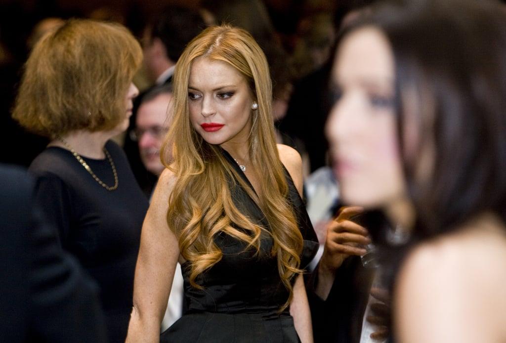 Lindsay Lohan wore an elegant black dress to the White House Correspondant's Dinner.