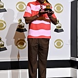 Accepting his Grammy in a Golf le Fleur shirt he designed with Lacoste.