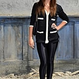 Julia Restoin Roitfeld's skinny black leggings and black and white cardigan felt right on the money at the Chanel show.