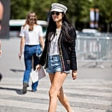 Keep a t-shirt-and-shorts outfit elevated with a tweed jacket and sleek sandals.