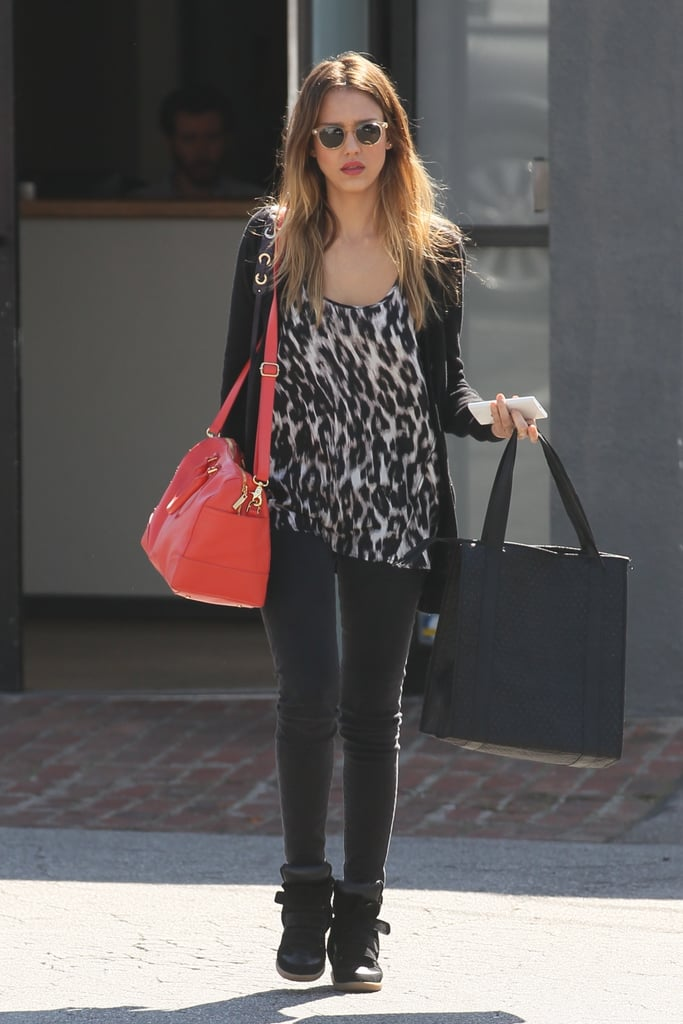 Jessica's all-black LA look was the perfect backdrop to make her leopard-print top and bright orange Tory Burch tote really pop.