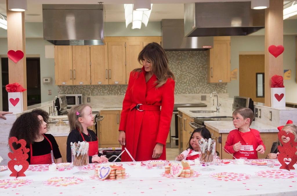 Melania Trump Red Calvin Klein Coat on Valentine's Day