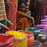 Customers waited to buy colored powder known as gulal in Siliguri, India.