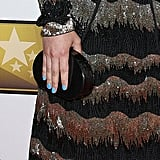 Ginnifer Goodwin selected an understated black Lauren Merkin clutch, but her blue nails added a cool contrast.