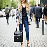 This styler played the transitional weather just right with an oversized blazer and a pair of wood-soled platforms. Source: Adam Katz Sinding
