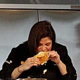 At her pizza demonstration, Alex Guarnaschelli contemplated the height of her double-decker pizza, then dug in anyway.