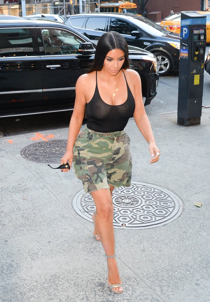 The Kardashian-Jenner clan really love going bra-less, don't they? On Tuesday, Kim Kardashian hit the town with Kendall Jenner in an NSFW outfit. While her half-sister flaunted her long legs in  a floral dress, the mother of North and Saint had no qualms walking around NYC in a sheer top and camouflage shorts. Let's just say, her revealing outfit left little to the imagination. And it definitely can't be a coincidence that she pulled the same stunt in the big city exactly one year ago. Of course, we wouldn't expect anything less from Kim. Her sexy selfies on social media are always fogging up our screens.       Related:                                                                                                           All the Times You Just Couldn't Look Away From Kim Kardashian's Cleavage