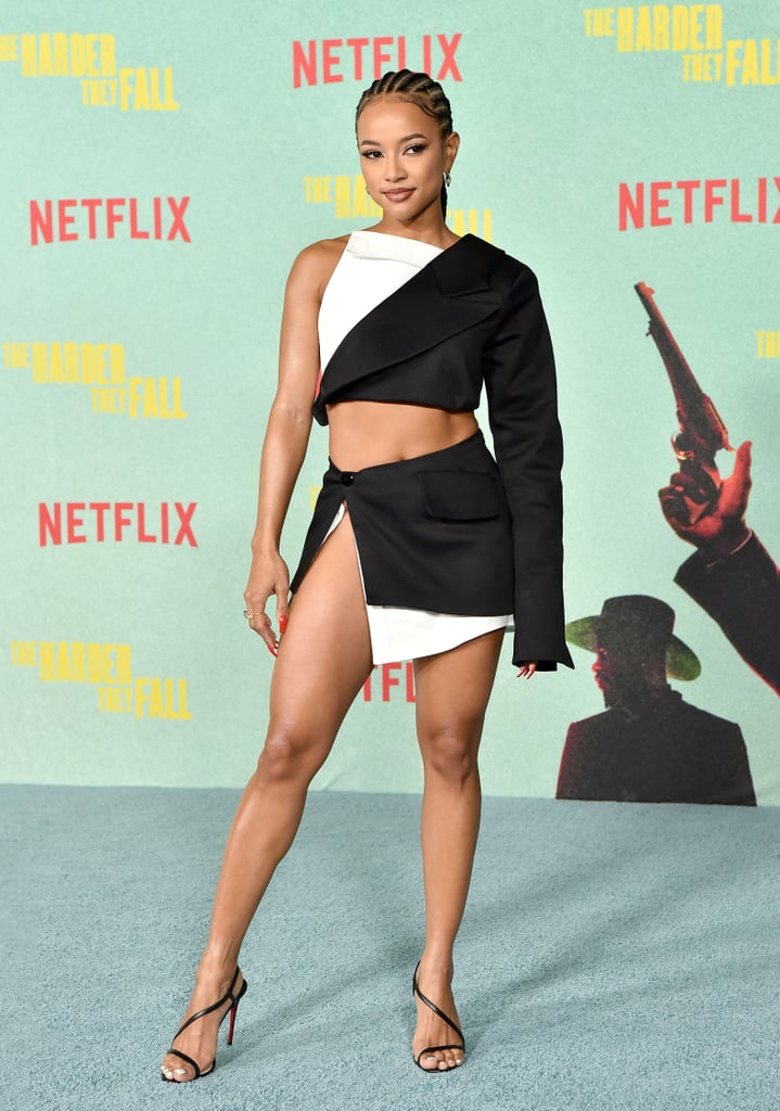 In a sea of celebrities in Hollywood, be like Karrueche Tran and let loose on the red carpet. On Oct. 13, the actress and model attended the premiere of Netflix's The Harder They Fall in Los Angeles where she exuded confidence and fabulousness in a sexy black-and-white set from Lionne Clothing. Karrueche's ensemble was right off the brand's FW21 RTW runway, and she brought the outfit to life with her poses and ear-to-ear smiles.  The asymmetrical cropped Naomi Top resembled a broken-down blazer with a white trim. She paired the top with the matching Naomi Skirt, which was held together by a button and a high slit up the side. The outfit was a super cool spin on a suit making it the perfect red carpet 'fit. It's clear that Karrueche's a big fan of the brand, as she stunned in a gorgeous rose quartz halter gown with a high slit down the leg from Lionne back in July. Check out photos of Karrueche's sexy spin on a broken-down blazer ahead.      Related:                                                                                                           Beyoncé's Black Velvet Gown Took 10 Days to Make, and Boy, Was It Worth the Wait