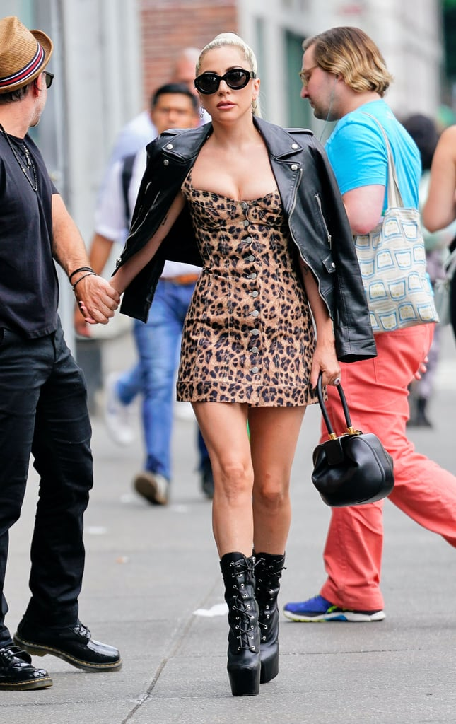 Wearing a button-through leopard dress by Miaou with a Saint Laurent leather jacket, Giuseppe Zanotti boots, a Gabriela Hearst bag, and Alaïa sunglasses.