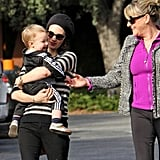 January Jones smiled as Xander played with her mom, Karen, during an LA outing.