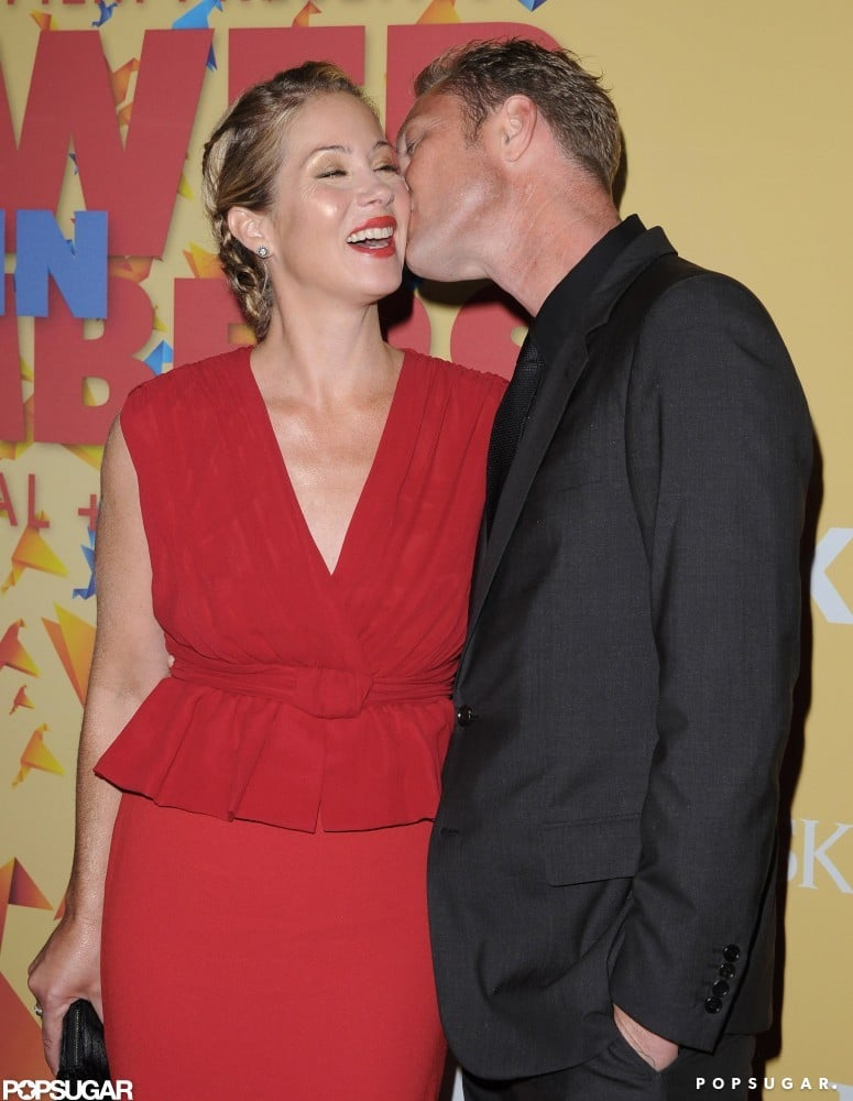 Christina Applegate got a kiss on the cheek from Martyn LeNoble at LA's Women in Film Crystal Lucy Awards in June.