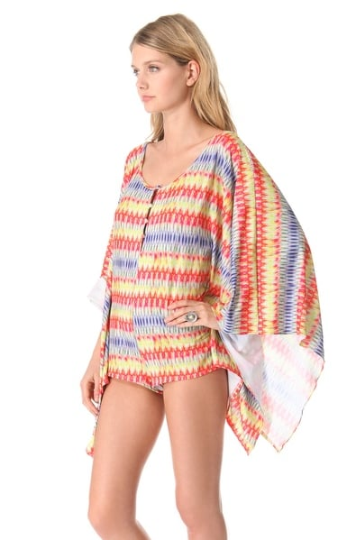 This PilyQ printed romper ($132) would look just as good on the street as it would on the sand. We especially love the butterfly sleeves.