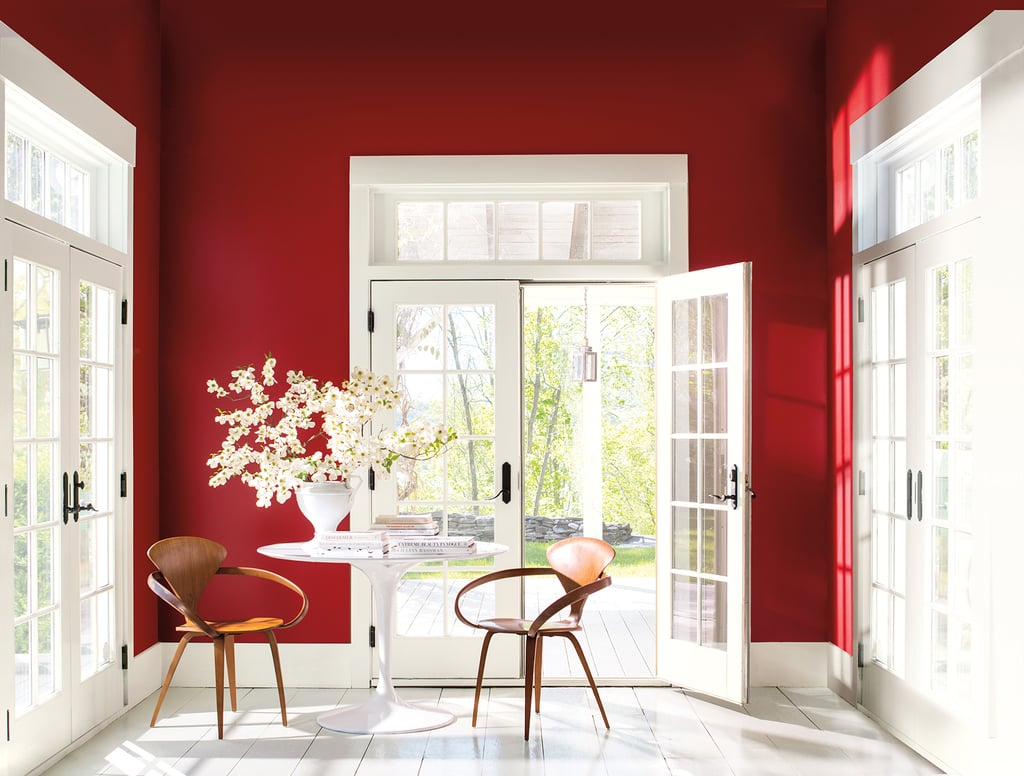"While others in the industry are leaning toward rich jewel tones, sticking with safe grays, or experimenting with chalky modern farmhouse hues, Benjamin Moore is taking a bold stance. The paint giant just announced its color of the year, and it's not what we were expecting: ""caliente"" (an energetic red).  The charismatic hue was selected after Benjamin Moore conducted a year-long deep dive into international design trends, looking across realms, from art to architecture. What it saw was red hues emerging around the world. ""Strong, radiant and full of energy, Caliente AF-290 is total confidence. It is pleasing, passionate and makes people feel special, like 'red carpet treatment',"" Ellen O'Neill, the company's director of strategic design intelligence, said in a statement.  From a bright pop on an accent wall to an entire room sheathed in it, caliente is sure to turn heads in 2018. See for yourself ahead.      Related:                                                                                                           Top Interior Designers Reveal Their Go-To White Paint"