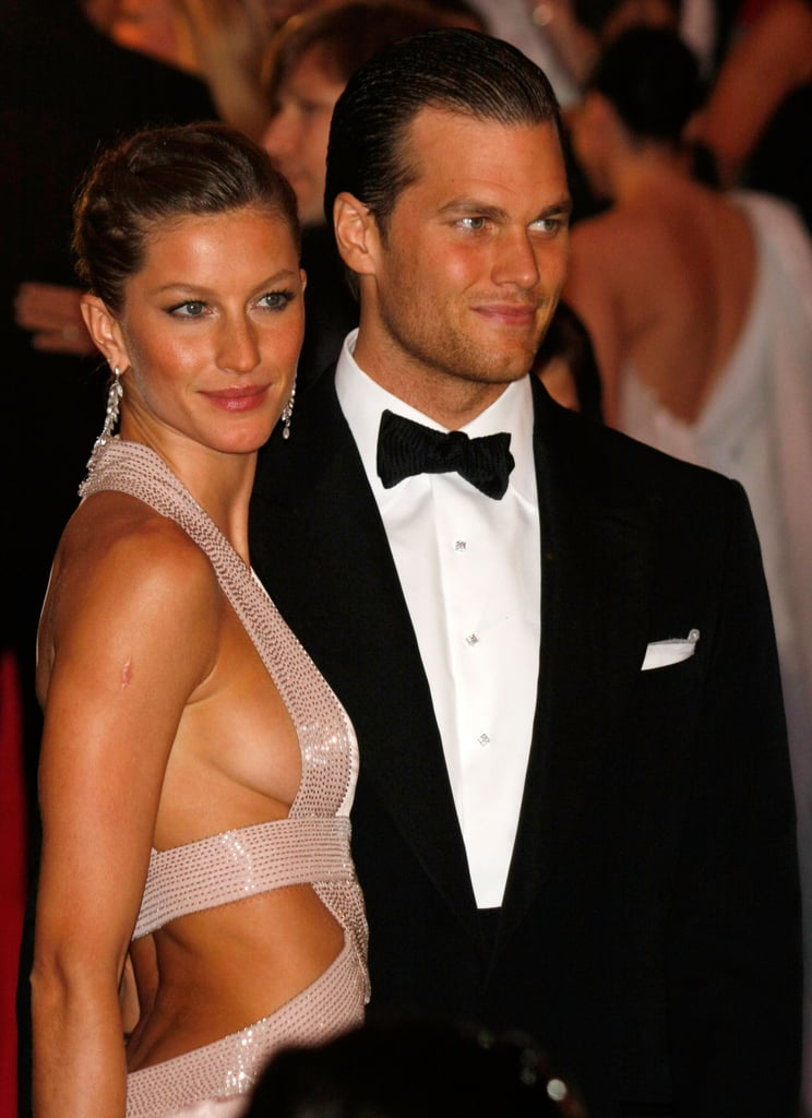 At the Met Gala just one year later, Gisele stunned with a slicked-back style and dangly earrings with then-boyfriend Tom Brady.