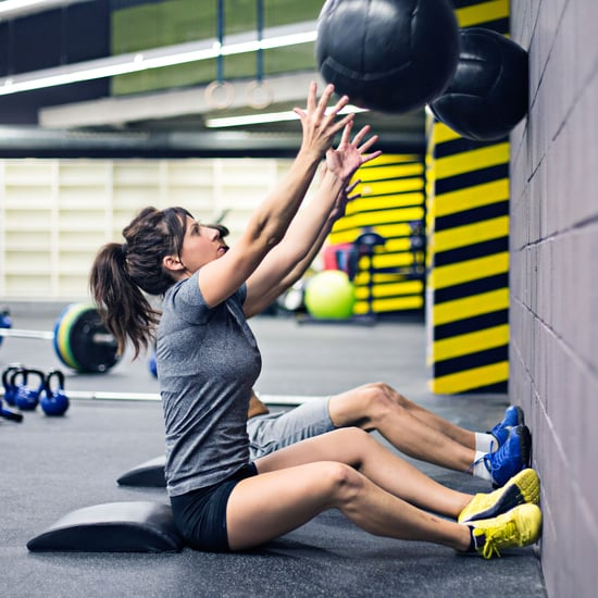 How to Do a Wall Ball Sit-Up to Strengthen Abs and Arms