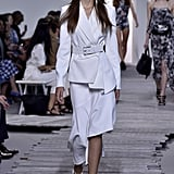 Perhaps Melania will shop the lighter side of Michael Kors's Spring 2018 offering, making a statement in this white asymmetrical suit. It's certainly got the waist-defining element the FLOTUS favors.