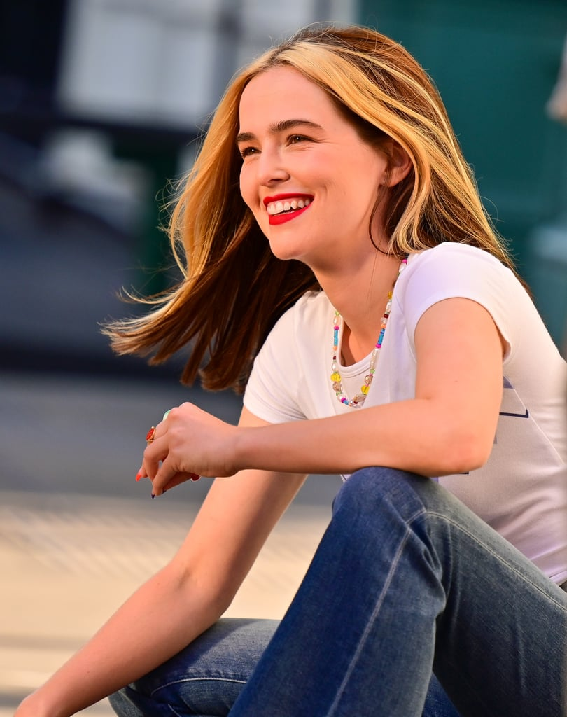 """Zoey Deutch is wearing the hell out of her new hairstyle. On July 30, the actress was spotted filming her film Not Okay in NYC and it looks like her character is, like, totally feeling the '90s. As Deutch introduced """"Danni Sanders"""" to the world, her """"money piece"""" highlights are already getting love from the actress's real-life friends on social media.  """"Wait I love your hair like this,"""" Riverdale's Madelaine Petsch commented, with stylist Samantha McMillen adding, """"I had that same hair in 1992."""" These chunky highlights echo the trend from two decades ago, and in Deutch's case, the blond pieces provide a brightening effect around her face. """"I love the technique because it frames the face and makes the complexion glow,"""" colourist Rachel Bodt told POPSUGAR previously. """"It's the hair colour equivalent to highlighter or makeup contour."""" Get a look at Deutch's new look in the photos, ahead.       Related:                                                                                                           It Wasn't Just 2020 —Celebrities Have Been Launching Beauty Brands For the Past 30 Years"""