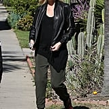 We love how Gwen paired a loose black tee with army-green pants and a leather jacket for that quintessential cool-girl vibe.