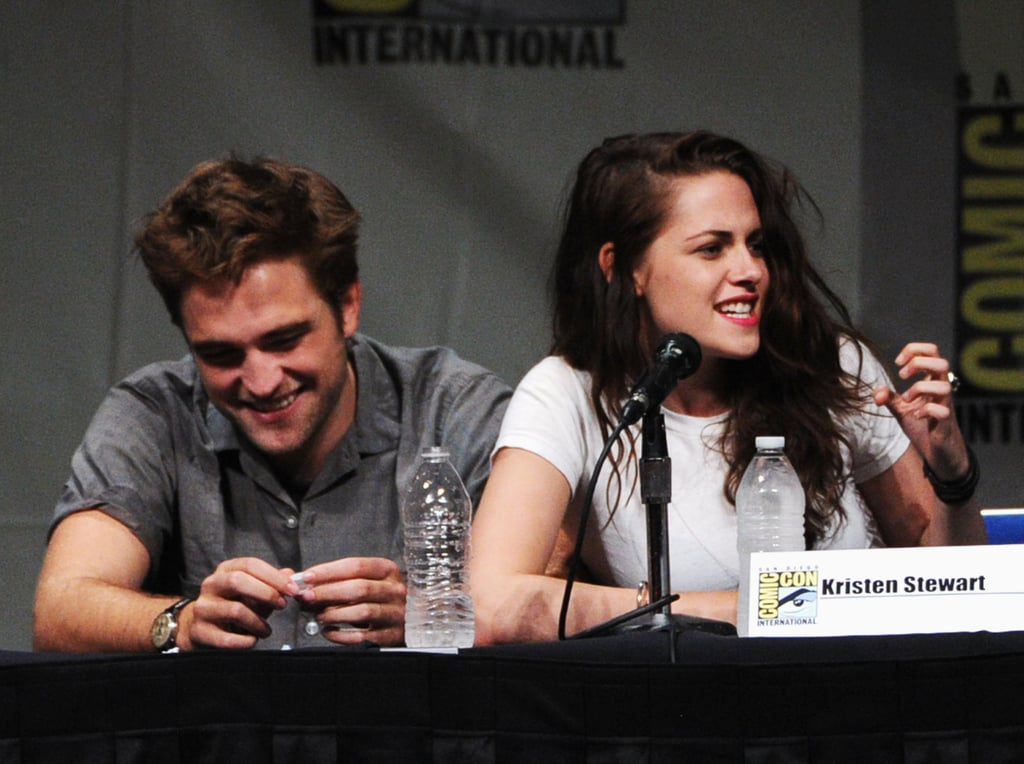 Robert Pattinson stayed close to Kristen Stewart as the two spoke to Comic-Con attendees in San Diego at a panel for Breaking Dawn Part 2 in July 2012.