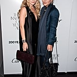 Twinning combo: In October 2012, the Olsen sisters hit the WSJ Magazine's Innovator of the Year Awards in moody hues, both by The Row.  Ashley worked a silky black V-neck dress with pleated panels, while toting all her party essentials in a burgundy bag by The Row. Mary-Kate beat the Winter blues in a sleek navy suit of tapered pants and a tailored blazer featuring a soft waterfall detail.