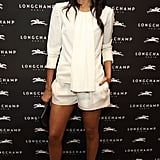 Saldana showed off her gorgeous gams in a draped-front silk shorts suit from Longchamp's Spring 2014 collection in September 2013.