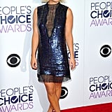 She did the same at the People's Choice Awards, amping up her sparkly dress with Dior kicks.