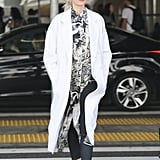 Karlie Kloss kept things casual with a loose scarf and light duster coat.