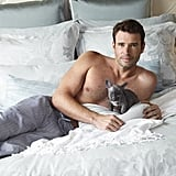 Shirtless Scott Foley Holding Puppies in Charisma Campaign