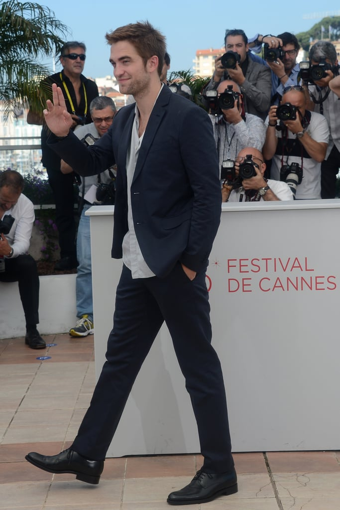 Robert Pattinson drew a large crowd at the Cannes Film Festival in France this morning. He stepped out for a photocall to promote Cosmopolis after also talking up the project on Le Grand Journal yesterday. Rob will be back in front of the cameras for the premiere of the film later today, though he's already made his red-carpet debut at this year's festival. Rob supported girlfriend Kristen Stewart by showing up at the screening of her movie On the Road, which also stars his pal Tom Sturridge. The fun continued after the event when Rob and Kristen kissed on the balcony of Le Baron's Cannes outpost. Kristen is apparently still in the South of France, but we'll have to wait and see if she makes another red-carpet appearance with Rob this afternoon.