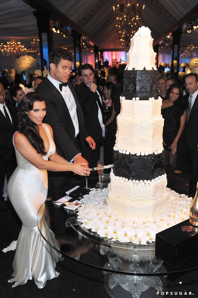 They cut their enormous wedding cake.