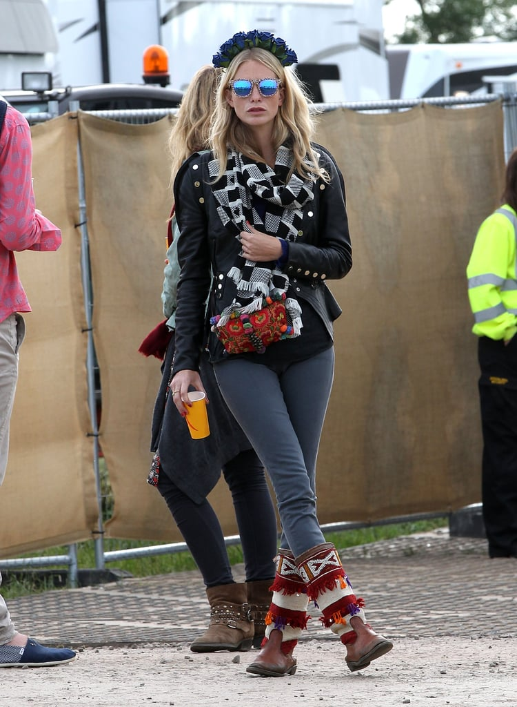 Even when dressing for nippy weather, Poppy Delevingne made sure her outfit felt festival-y, thanks to mirrored Topshop sunglasses and a floral wreath.