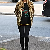 She accessorized her leopard print jacket with a black fedora when she went on a walk in North London in October 2016.