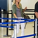 Gwyneth Paltrow Shows Her Bra at LAX | Pictures