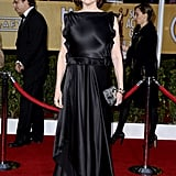 Sigourney Weaver wore a silk black dress to hit the red carpet.