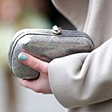 A light-gray coat was paired up with a metallic minaudière for a touch of shine.