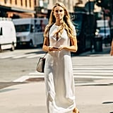 A cotton midi dress and gladiator sandals is a classic summer combination that stands the test of time.