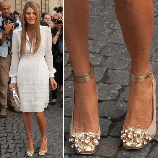 Anna Dello Russo paired a gem-studded Yves Saint Laurent ankle-strap silhouette with a breezy white Valentino sheath.