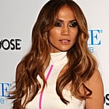 J Lo changed into a sexy white and pink mini dress for the afterparty.
