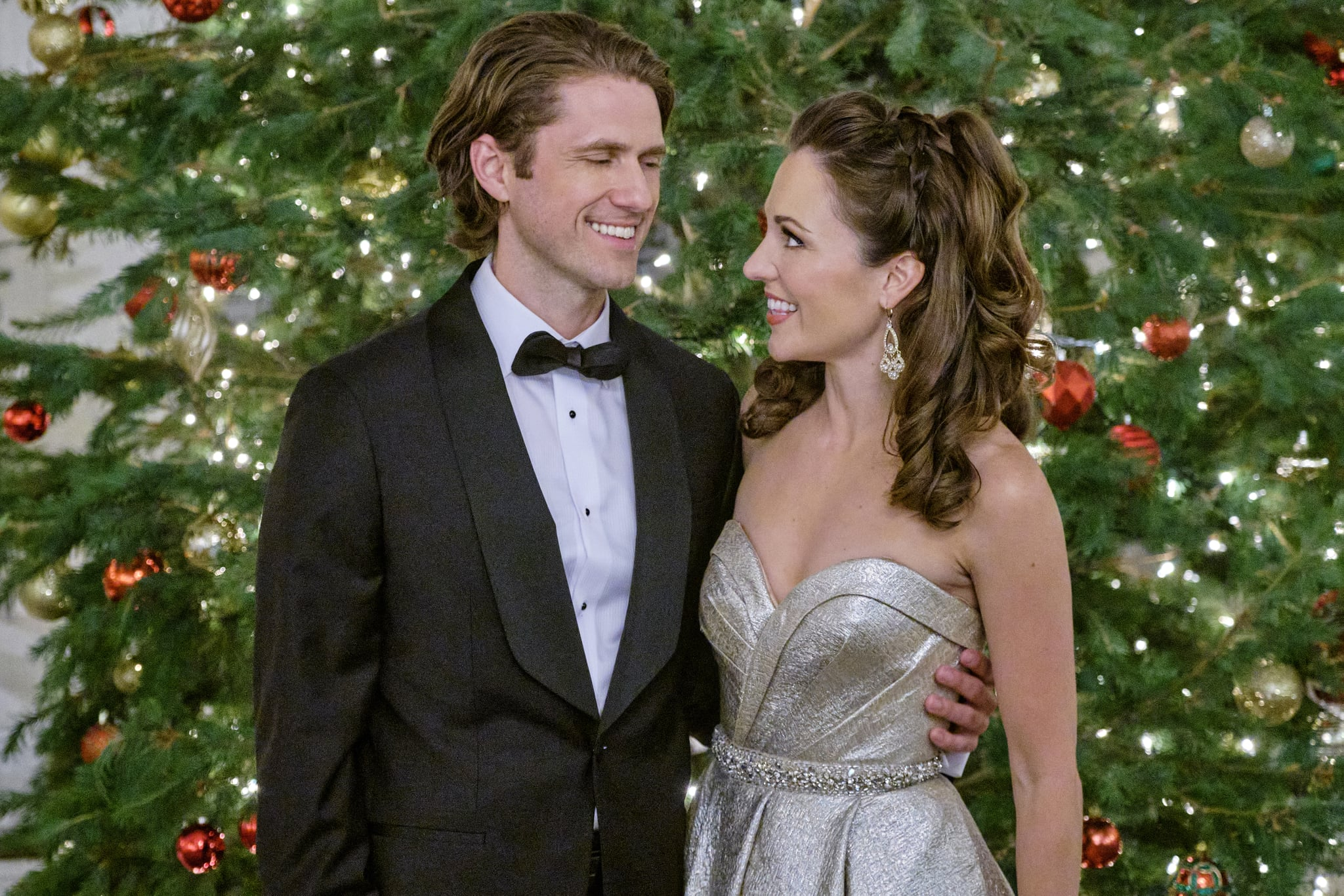 When Anna offers a stranded mother and son shelter in a blizzard, she learns that they are the Royal Family of Galwick.  Anna shows the Prince how they do Christmas in her hometown of Kentsbury, Connecticut encouraging him to open his heart and be true to himself.  Photo: Aaron tveit, Laura Osnes   Credit: ©2020 Crown Media United States LLC/Photographer: Robert Clark