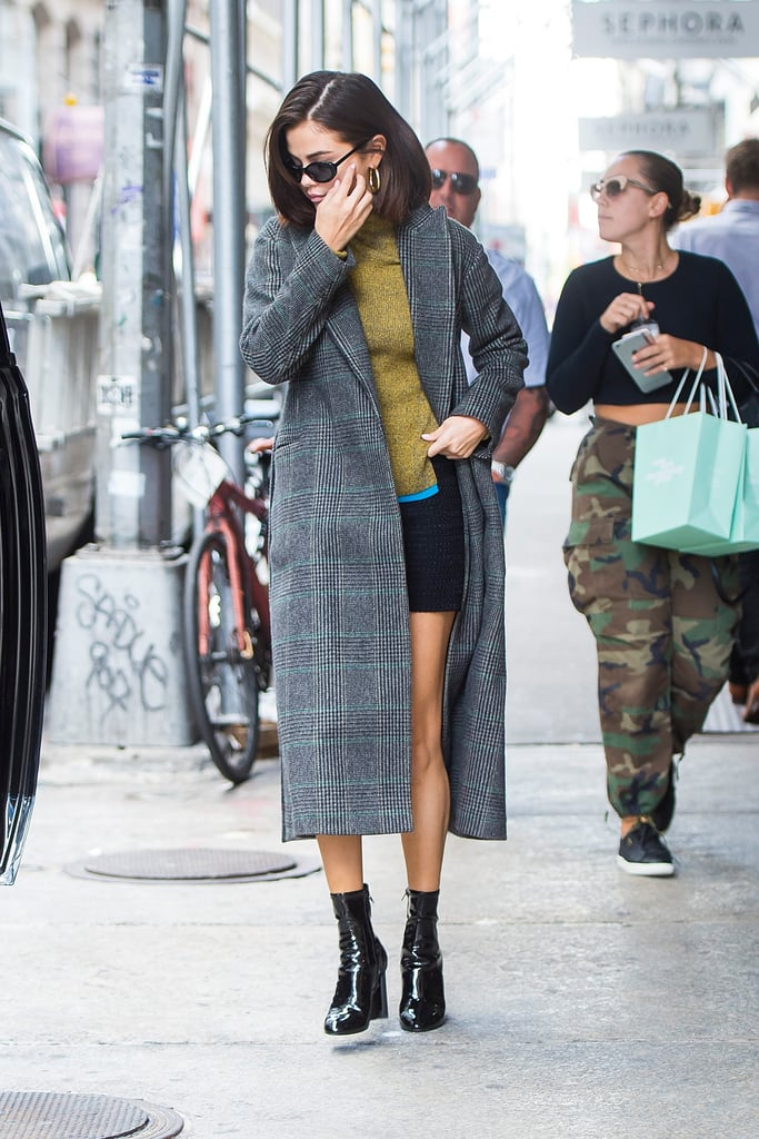 She Styled It With a Green Sweater, Mini Skirt, and Ankle Boots