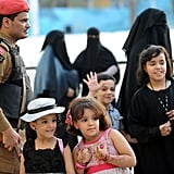Saudi children looked on in front of a security guard after the morning Eid al-Fitr prayer.