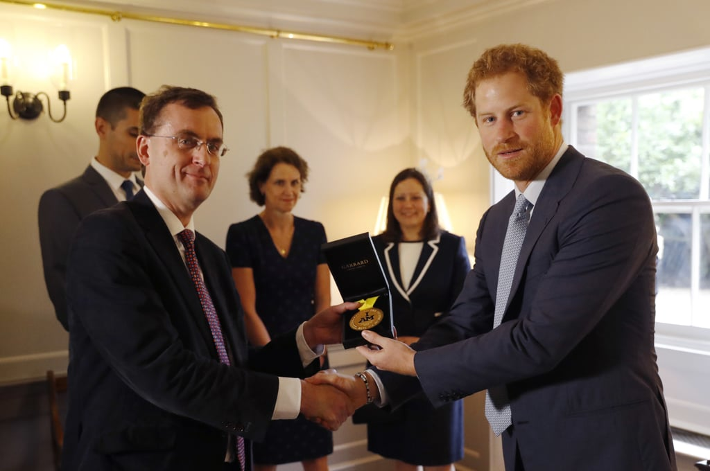 After Sergeant Elizabeth Marks won gold at the Invictus Games in Orlando, FL, she asked Harry to personally donate the medal to Papworth Hospital in the UK as a thank you for saving her life in 2014. In June, the prince fulfilled her request by presenting the medal to Dr. Alain Vuylsteke.