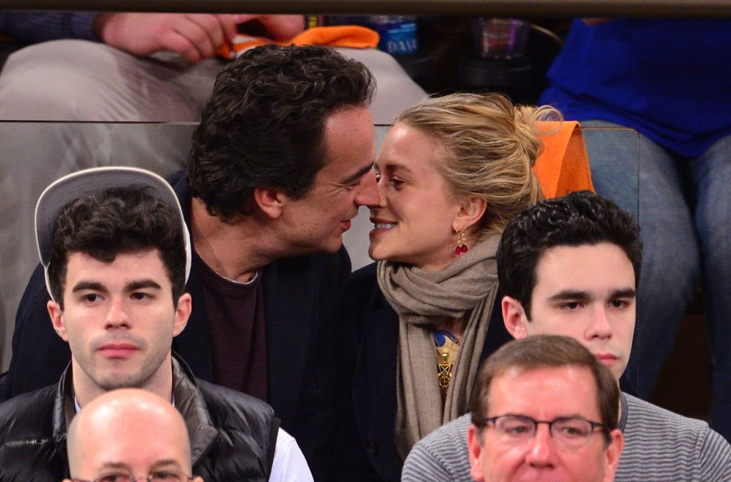 Mary-Kate Olsen and Olivier Sarkozy showed love last night at a Knicks game at NYC's Madison Square Garden. It seems the duo can't help but indulge in PDA courtside —they've been photographed cuddling during at least eight games since last November! They're also apparently good-luck charms for the team. Last night, the Knicks beat the visiting Boston Celtics, 87-71. It was an especially important win since it was a playoff match, and now the Knicks are up 2-0 in their three-game series with the Celtics. The third game takes place Friday night in Boston.