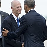 President Obama shakes hands with Florida Republican Governor Rick Scott at the Orlando International Airport.