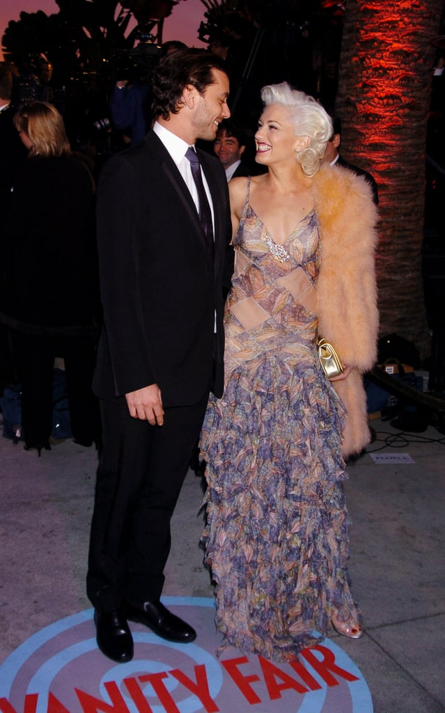 The duo smiled at each other during the Vanity Fair Oscars party in February 2004.