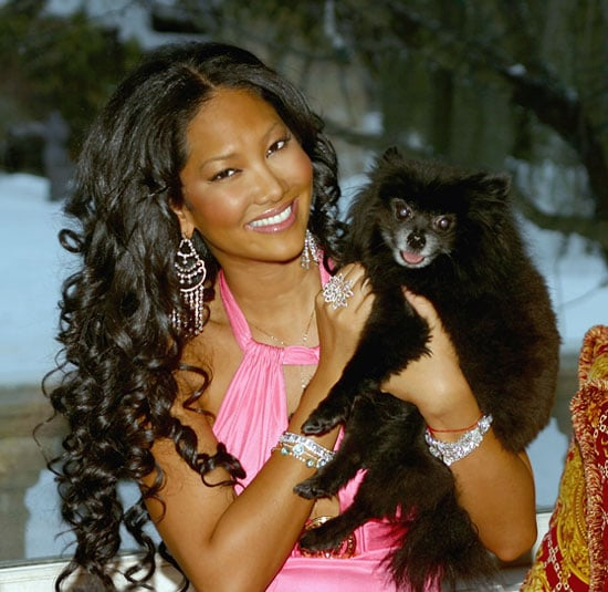 Model Kimora Lee Simmons poses for a portrait with her dog at home February 24, 2005 in Saddle River, New Jersey.