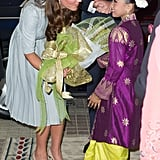 Kate may have been arriving for lunch with the prime minister, but she made time for a sweet greeting with this little girl during her September 2012 stop in Malaysia.