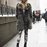 A begging-to-be-touched fur in a subtle gray hue added luxe to printed pants and a fedora.