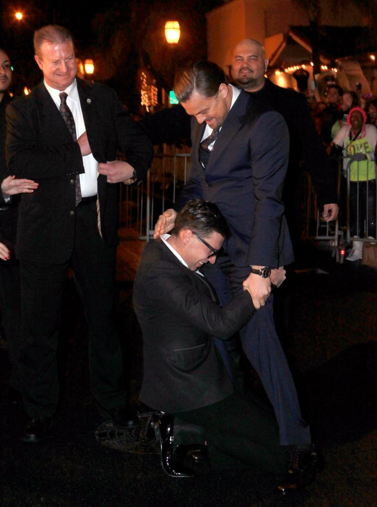 Leonardo DiCaprio couldn't help but laugh when a man ran over and hugged his crotch when he attended the Santa Barbara Film Festival in California yesterday. The actor got grabbed by notorious Ukranian prankster/crotch hugger Vitalii Sediuk, who recently pulled this stunt on Leo's friend Bradley Cooper at the SAG Awards. We guess Vitalii must be seeing the similarities between Bradley and Leo too! Leo and his frequent collaborator and The Wolf of Wall Street director, Martin Scorsese, were at the festival to be honoured with the Vanguard Award. Leo's co-star Jonah Hill was also at the event, although he didn't get attacked for a crotch hug during his time on the red carpet. We guess there's always time for that at the Oscars! Keep reading to see Bradley's SAGs incident and Leo's effortless way of handling the prankster.